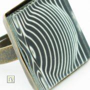 Vasarely fekete alapú kör gyűrű